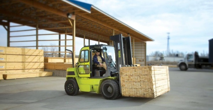 How Do You Know When to Update Your Forklift Fleet? Featuring a yellow Clark forklift.